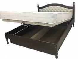 Кровать с ящиками или подъемным механизмом – что лучше?